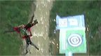 Three base jumpers, having launched from the bridge, falling together