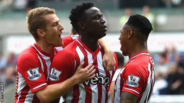 Victor Wanyama (centre) celebrates his goal at the Liberty Stadium