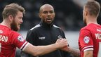 Danny Gabbidon congratulates Cardiff players Aron Gunnarsson and Anthony Pilkington