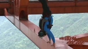 Base jumper on bridge