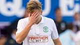 Dejection for Hibernian's Jason Cummings after his side is defeated by Queen of the South
