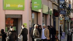 People queuing outside Job Centre Plus office in London