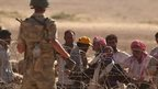 Turkish troops face Kurdish refugees at border (21/09/14)