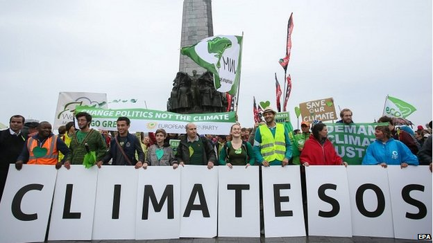 Protesters march to demand urgent action on climate change in Brussels, Belgium - 21 September 2014