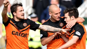 Dundee United players celebrate their third goal