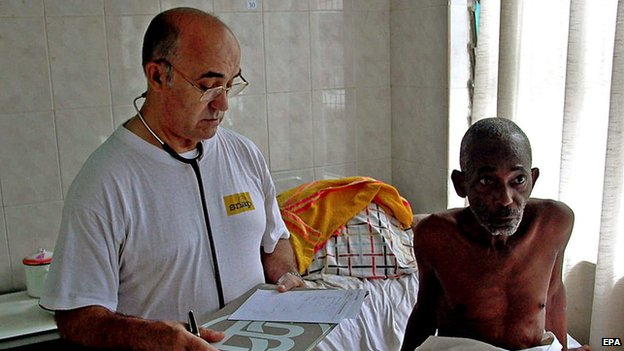 An undated handout photo released by Spanish aid organisation Juan Ciudad ONGD, shows Spanish doctor and missionary Manuel Garcia Viejo (L) working at the San Juan de Dios Hospital in Lunsar, Sierra Leone