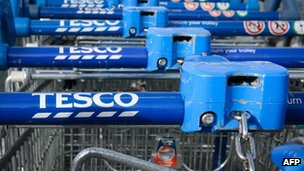 A group of Tesco shopping trolleys