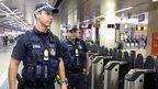Police officers patrol Central rail station in Brisbane, Queensland, Australia, 15 September 2014.
