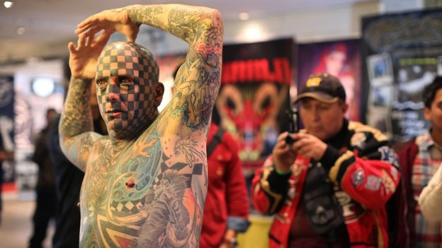 Heavily tattooed man