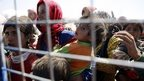 Syrian refugees wait to cross border into Turkey. 22 Sept 2014