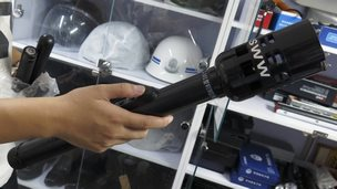A photo made available on 23 September 2014 shows a torch that also functions as an electric shock device, displayed in a security equipment shop in Beijing on 19 September 2014