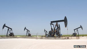 Oil pump jacks pump oil at Al-Jbessa oil field in Al-Shaddadeh town of Al-Hasaka governorate,