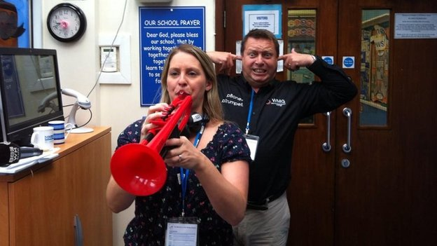 Michelle Dawes playing a plastic trumpet