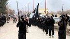 File photo: Fighters from the Islamic State group march in Raqqa, Syria, in this undated file image posted on a militant website on 14 January 2014