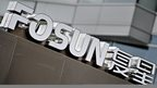 Fosun Group logo in front of the company's headquarters building in Shanghai