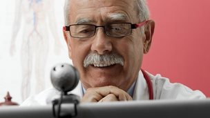 Doctor looking at a webcam