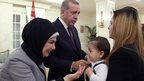 Turkish President Recep Tayyip Erdogan (2nd L) and his wife Emine (L) greeting some of the freed Turkish consulate hostages (21 Sept)