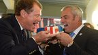 Tom Watson (left) and Paul McGinley share a Ryder Cup themed cake