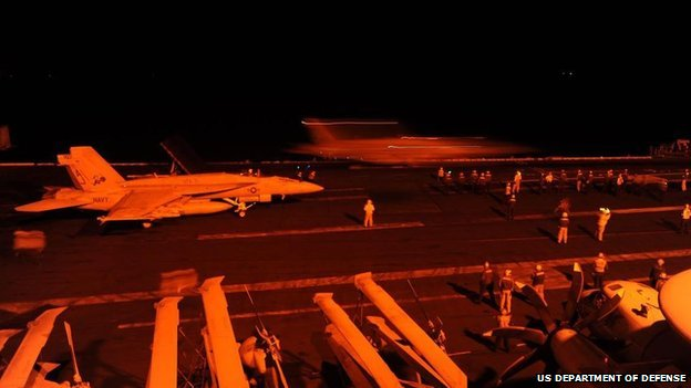 F/A-18s launch attacks on IS targets from aircraft carrier USS George HW Bush
