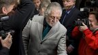 Dave Lee Travis leaves court