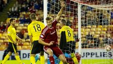 Ash Taylor celebrates after scoring for Aberdeen against Livingston
