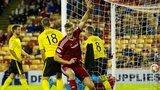 Ash Taylor celebrates after scoring for Aberdeen against Livingston