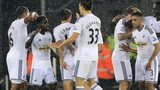 Swansea midfielder Nathan Dyer (second left) celebrates with team-mates