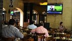 Residents watch the news in a coffee shop in Damascus in Syria - 23 September 2014