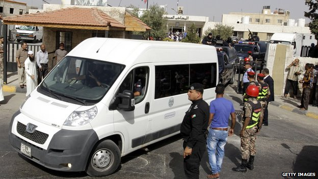 Van carrying Abu Qatada arrives at court in Amman, Jordan, ahead of the verdict