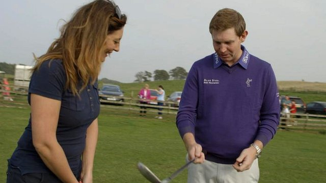 BBC Scotland's Catriona Shearer is given a golf lesson from Stephen Gallacher