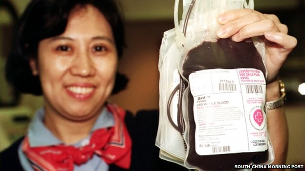 Chinese nurse holds blood bag