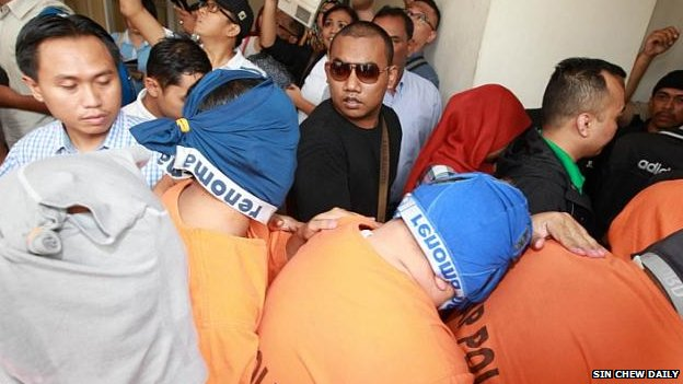 Malaysian customs officers arrive in court