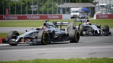 Jenson Button and Kevin Magnussen compete for McLaren