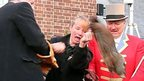 New York Mayor Bill de Blasio, left, winces as Staten Island Chuck breaks free and drops to the stage during the 2014 Groundhog Day ceremony at the Staten Island Zoo, in New York.