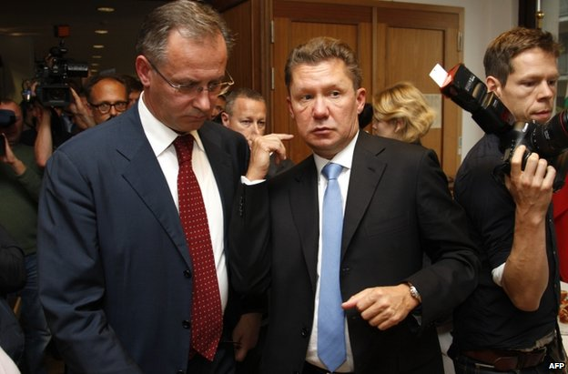 Gazprom CEO Alexei Miller (C) and Russian Energy Minister Alexander Novak (L) leave the talks in Berlin, 26 September