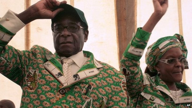 Zimbabwe President Robert Mugabe, left, and his wife Grace, right, in Bindura, Zimbabwe - December 2008