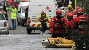 Fire crews used a dinghy to rescue people from their homes in Kingswood after a burst water main