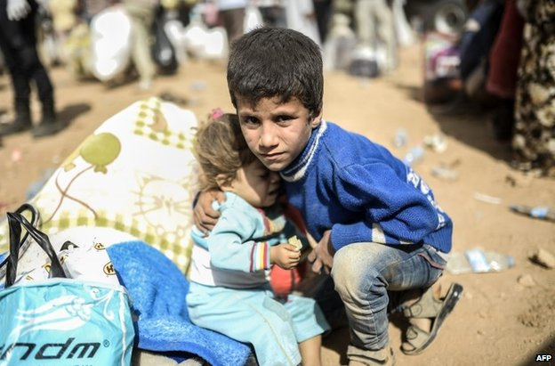 Syrian Kurdish refugees on the Turkish side of the border at Suruc, 27 September
