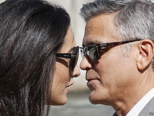 George Clooney and his fiancee Amal Alamuddin arrive in Venice, 26 September