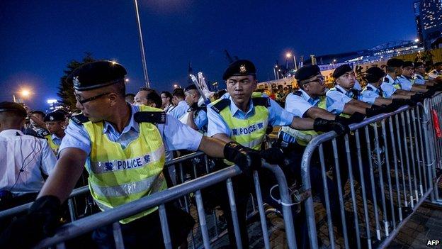 Police protect a cordon outside government offices in Hong Kong. 28 Sept 2014