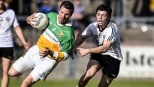 Carrickmore's Conor Gormley attempts to get past Omagh's Ciaran McLaughlin in the Tyrone Football Final