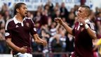 Osman Sow (left) celebrates with fellow Hearts scorer Soufian El Hassnaoui after making it 3-0