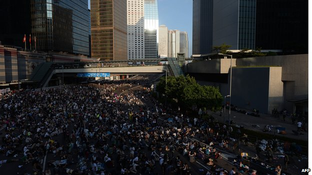 Hong Kong protestors rest after clashing the previous night with police