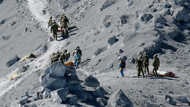The bodies of some of the victims were brought down from the volcano on Sunday