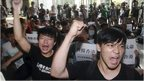 Hong Kong and Taiwanese student demonstrators shout slogans in support of pro-democracy protests taking place in Hong Kong at the Hong Kong Economic, Trade and Cultural Office in Taipei, Taiwan, Monday, 29 Sept, 2014.