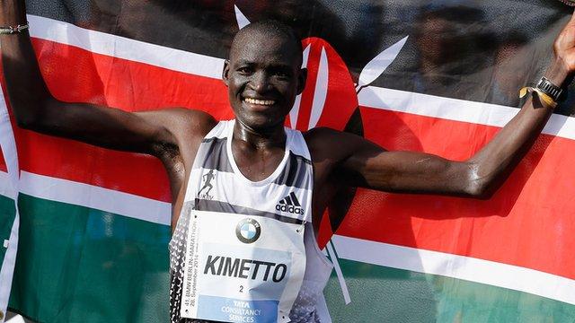 Kenya's Dennis Kimetto celebrates after breaking the marathon world record
