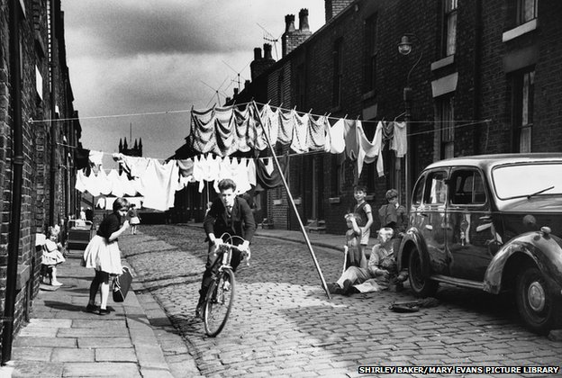 Cycling along a terraced street, Salford, Manchester 1962