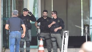 Police special forces deployed at a hotel where a man kept a hotel employee hostage in Brazilia 29 Sept 2014