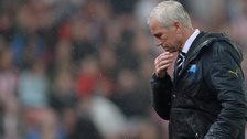 Newcastle United manager Alan Pardew wipes rain off his face during the Stoke match