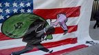 US flag with vulture carrying bag of dollars